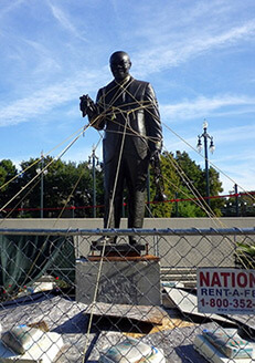 Cory Doctorow, Roped-up Satchmo statue, Louis Armstrong Park, New Orleans, Louisiana, 2010.  Area closed off since contractors poured pavement with bad cement and damaged the statue.