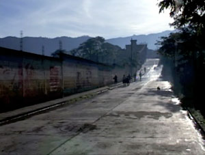 People, road, and wall from Brother Towns, 2010.