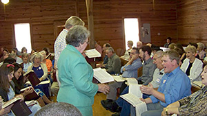 James Robert Chambless, Michael Thompson and Joyce Walton lead a song at a Sacred Harp singing, Holly Springs Primitive Baptist Church, Bremen, Georgia, June 2, 2012.