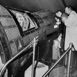 Richmond Times-Dispatch, Ralph Rogers peering into a space capsule on exhibit at the Civil War Centennial Center, Richmond, Virginia, 1963.  Courtesy of the Valentine Richmond History Center.
