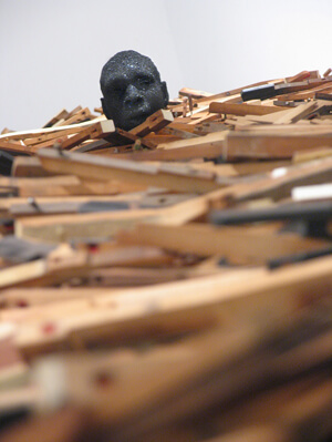 Radcliffe Bailey, Windward Coast, 2009-2011. Piano keys, plaster bust, and glitter, dimensions vary. Courtesy of Jack Shainman Gallery, New York.