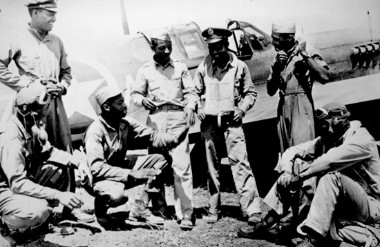 Photographer unknown, Tuskegee Airmen gathered at a U.S. base after a mission in the Mediterranean theater, February 1944. Courtesy of the United States National Archives and Records Administration.