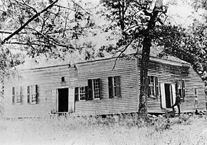 Waxhaw Presbyterian Church, Lancaster County, South Carolina. Built around 1800, it was the third meeting house of the congregation. This is the only known photograph of a meetinghouse the carvers themselves would have seen. Courtesy of Nancy Crockett.
