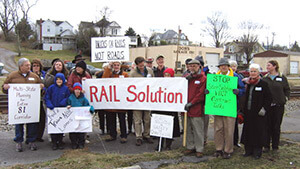 "Kathy Shearer, RAIL Solution rally along the I-81 Corridor, Abingdon, Virginia, 2005. Used with permission. RAIL Solution fought I-81 privatization and advocates a ""steel interstate system"" alongside the road."