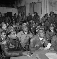 Toni Frissell, Photograph of several Tuskegee airmen attending a briefing in Ramitelli, Italy, March 1945. Courtesy of the Library of Congress.
