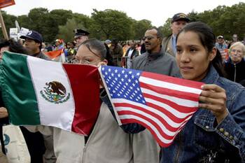 Stan Schnier, Women hold Mexican and American flags at the final Immigrant Workers Freedom Ride event, Flushing Meadows Corona Park, New York, New York, October 4, 2003.