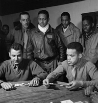 Toni Frissell, Tuskegee airmen playing cards in the officers' club in the evening, Ramitelli, Italy, 1945. Courtesy of the Library of Congress.