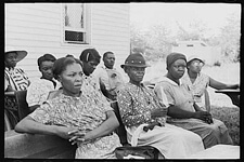 Lee Russell, Audience at Farm Security Administration listening to a speech by a visiting public health official, La Forge, Missouri, 1938. Courtesy of the Library of Congress.