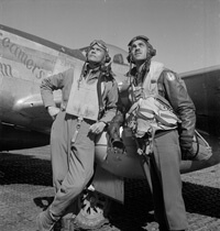 Toni Frissell, Col. Benjamin O. Davis, full-length portrait, and Edward C. Gleed, wearing flight gear, standing next to airplane, and looking upward, at air base at Ramitelli, Italy, 1945. Courtesy of the Library of Congress.