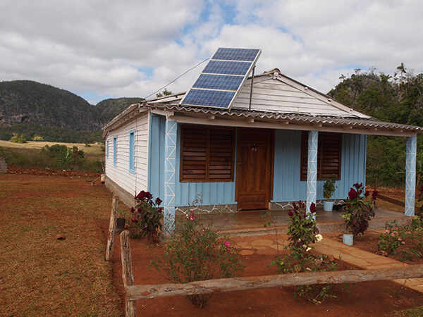Charles D. Thompson, Jr., Farmhouse fitted with solar collector provided by a grant from the French government. Viñales Valley, Cuba, January 2011.