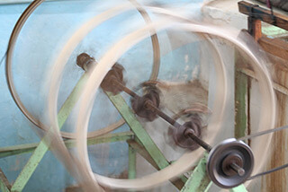 Mary E. Frederickson, Spinning silk thread, Margilan, Uzbekistan, 2006.