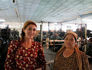 Mary E. Frederickson, Mother and daughter, both workers in the Margilan weave room, Uzbekistan, 2006.