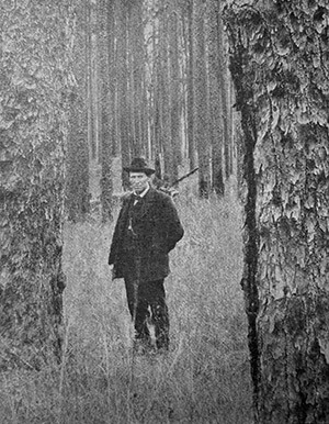 Unidentified lumberman in the Jackson Tract, outside Lockhart, Alabama. American Lumberman 1907, Part 1, January–June 1907, Forest History Society archive.