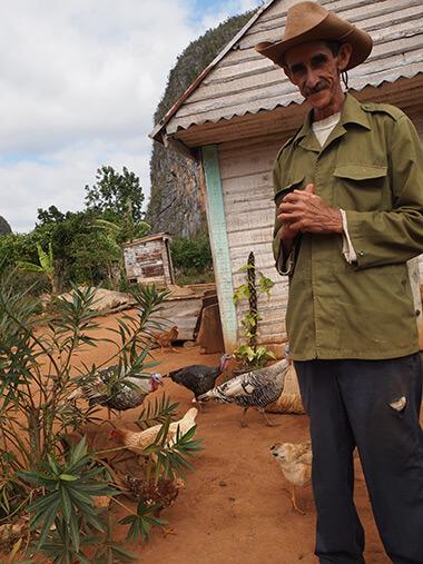 Charles D. Thompson, Jr., Tobacco farmer with his chickens and turkeys. Viñales, Cuba, January 2011.
