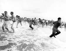 "Figure 54. Segregationists trying to prevent blacks from swimming at a ""white only"" beach in St. Augustine, St. Augustine, Florida, 1964. Courtesy of the State Archives of Florida."