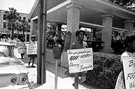 "Figure 55. Civil Rights demonstrations around the ""slave market,"" St. Augustine, Florida, 1964. Copyright Associated Press."