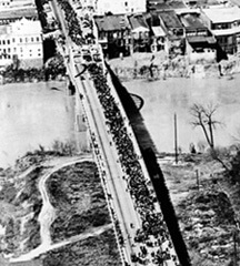 Aerial view of marchers crossing the Edmund Pettus Bridge, 1965.