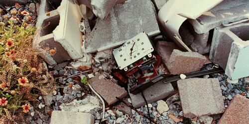 Bruce West, Clock in Debris of Destroyed Aquarium, Gulfport, Mississippi, 2006.