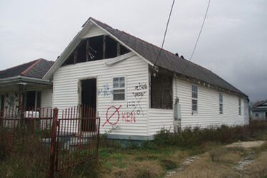 "Dorothy Moye, Upper Ninth Ward house with ""KEN"" marking from private contractor, 2009."