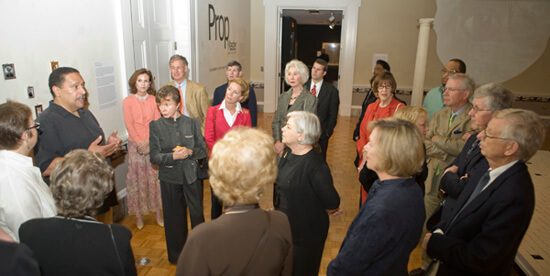 Paul Cheney, Page and Logan talk with museum visitors on Prop Master opening night, Charleston, South Carolina, April 2009.