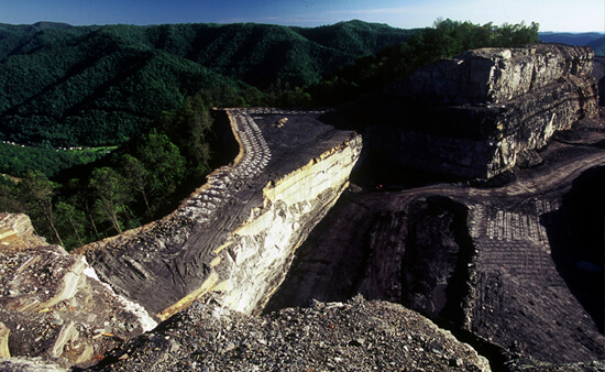 Mark Schmerling, A mountaintop removal site looms over the community of Dorothy, Raleigh County, West Virginia, 2008.