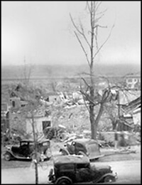 """Looking S.E. from Corner Church and Walnut Sts Tupelo Miss. Path of tornado of April 5, 1936 About 9 PM."""