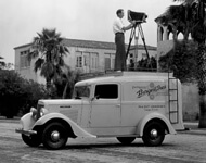 Burgert Brothers, Photographer and camera atop new Burgert Brothers truck parked by Davis Island pool building, Tampa, Florida, 1936. Catalog no.: PA 5906.