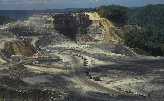Mark Schmerling, Massive machinery is dwarfed by the size of this mountaintop removal site, Kayford Mountain, Kanawha County, West Virginia, 2006.