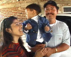 Photograph of Rosa, Miguel and their son.