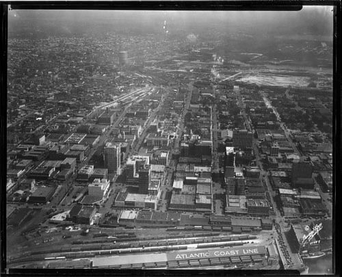 Burgert Brothers, Downtown Tampa aerial view, east from railroad sheds to Ybor, Estuary Zone, and gas storage tank Tampa, Florida, 1958. Catalog no.: PA 5858.