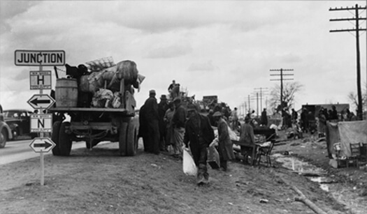 Arthur Rothstein, State highway officials moving sharecroppers away from roadside to area between the levee and the Mississippi River, New Madrid County, Missouri, January 1939. FSA-OWI Collection, Library of Congress, LC-USF33- 002975-M2.