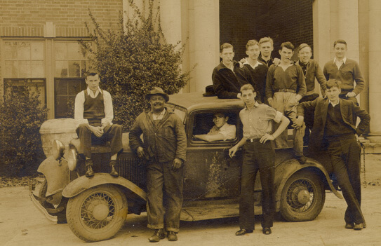 """Photographer unknown, College groundskeeper and chief janitor Henry """"Billy' Mitchell with Emory at Oxford students, c. 1940. Collection of J.P. Godfrey, Jr."""