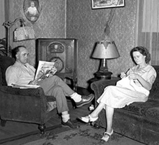 A couple listens to their radio, 1938