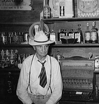 Russell Lee, Library of Congress, Prints & Photographs Division FSA-OWI Collection Reproduction Number: LC-USF34-031581-D DLC, Cajun proprietor of barroom, Crowley, Louisiana, 1938.