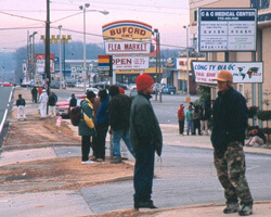 Day Laborers waiting for work on Buford Highway. Chamblee, Georgia. Photo by Mary Odem, 2001