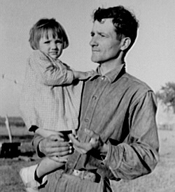 Russell Lee, Library of Congress, Prints & Photographs Division FSA-OWI Collection Reproduction Number: LC-USF33-011882-M5 DLC, Cajun farmer with daughter, Near New Iberia, Louisiana, 1938.