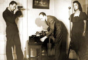Stetson Kennedy, Robert Cook (with camera) and Stetson Kennedy (with recording equipment) documenting Edith Ogden-Aguilar Kennedy, Ybor City, Florida, 1939.