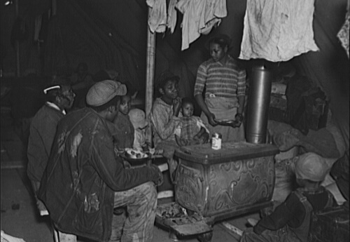 Russell Lee, Negro flood refugees at meal time, Charleston, Missouri, February 1937. FSA-OWI Collection, Library of Congress, LC-USF34- 010215-D.Russell Lee, Negro flood refugees at meal time, Charleston, Missouri, February 1937. FSA-OWI Collection, Library of Congress, LC-USF34- 010215-D.