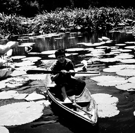 J.C. Boudreaux in his pirogue on Avery Island during filming of Louisiana Story, circa 1947.