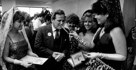Donn Dughi, Representative Elvin Martinez with Latin princesses and a cigar, Tallahassee, Florida, April 30, 1987. Catalog no.: Dnd0457. Florida Photographic Collection.