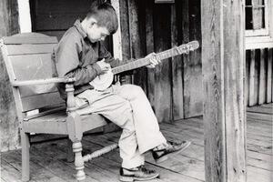 John Cohen, Boy with tin can banjo, KY, 1959