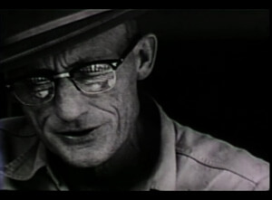 Closeup of Roscoe Holcomb playing guitar from The Highe Lonesome Sound
