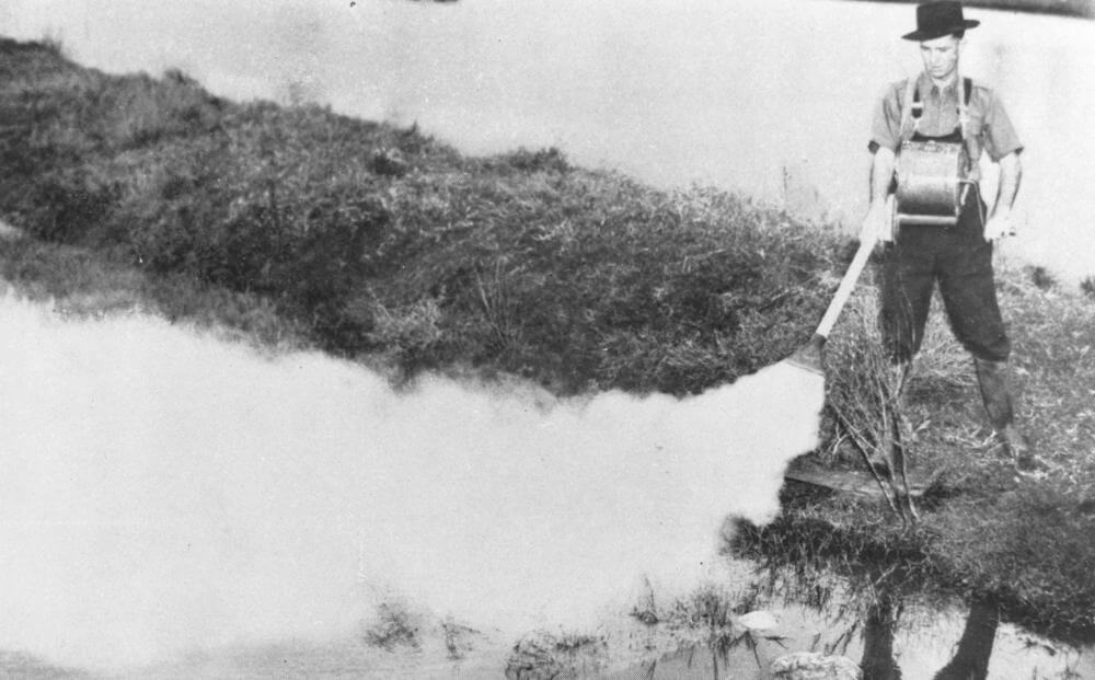 Council Worker spraying for mosquitos, Brisbane, 1949. Courtesy of State Library of Queensland and Wikimedia Commons. Creative Commons license CC BY-SA 2.5.