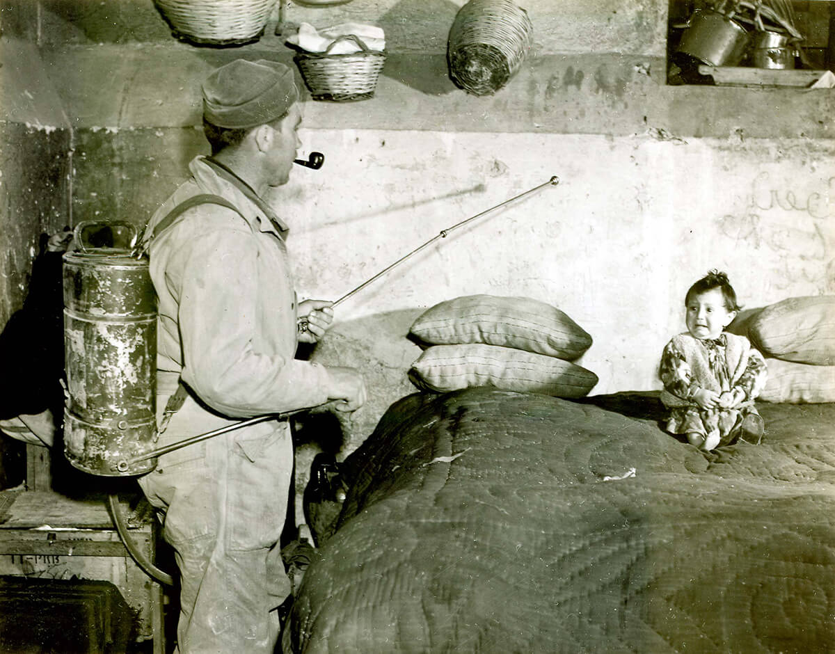 Spraying interior of Italian houses with 10% DDT and kerosene for malaria control, 32nd Field Hospital, Unit B Installation, February 26, 1945. Image by Flickr user Otis Historical Archives National Museum of Health and Medicine. Creative Commons license CC BY 2.0.