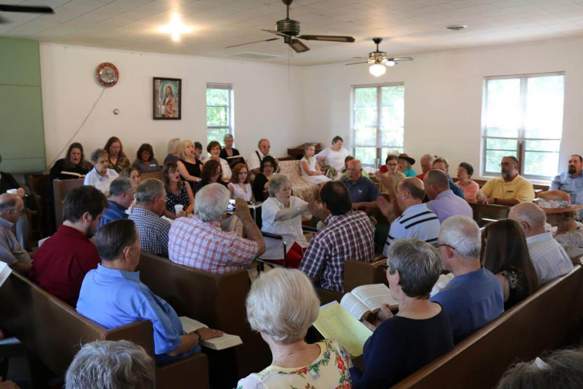 Daphene Causey of Alabaster, Alabama, leads at the 113th session of the Lookout Mountain Sacred Harp Singing Convention, Pine Grove Primitive Baptist Church, Collinsville, Alabama, August 27, 2016. Photograph by James Robert Chambless. Courtesy of the Sacred Harp Museum.