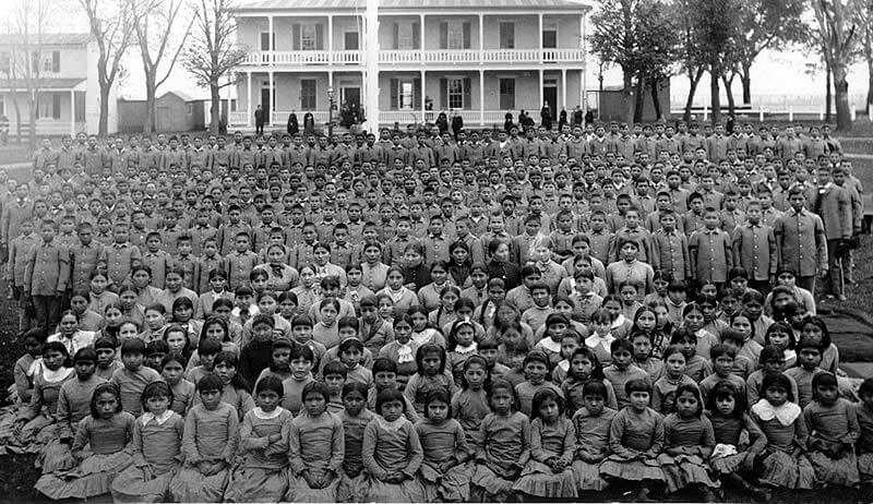 Pupils at Carlisle Indian Industrial School, Pennsylvania, ca. 1900. Photograph by unknown creator. Courtesy of Wikimedia Commons. Image is in the public domain.
