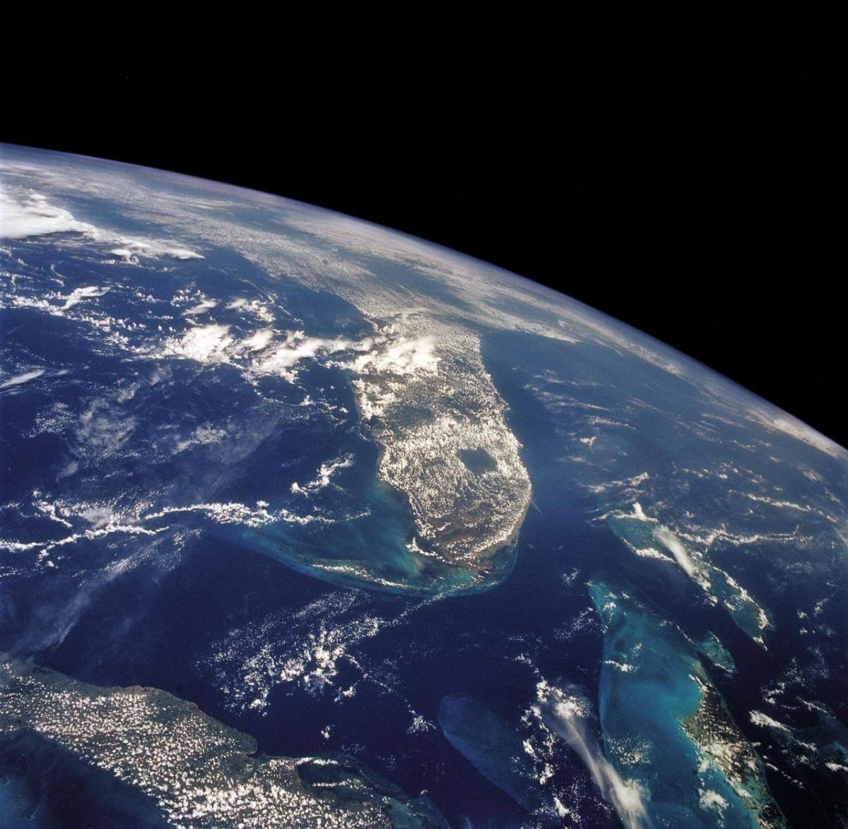 View of the Florida peninsula, western Bahamas, north central Cuba and the deep blue waters of the Gulf Stream, August 8, 1992. Image by Johnson Space Center, National Aeronautics and Space Administration.