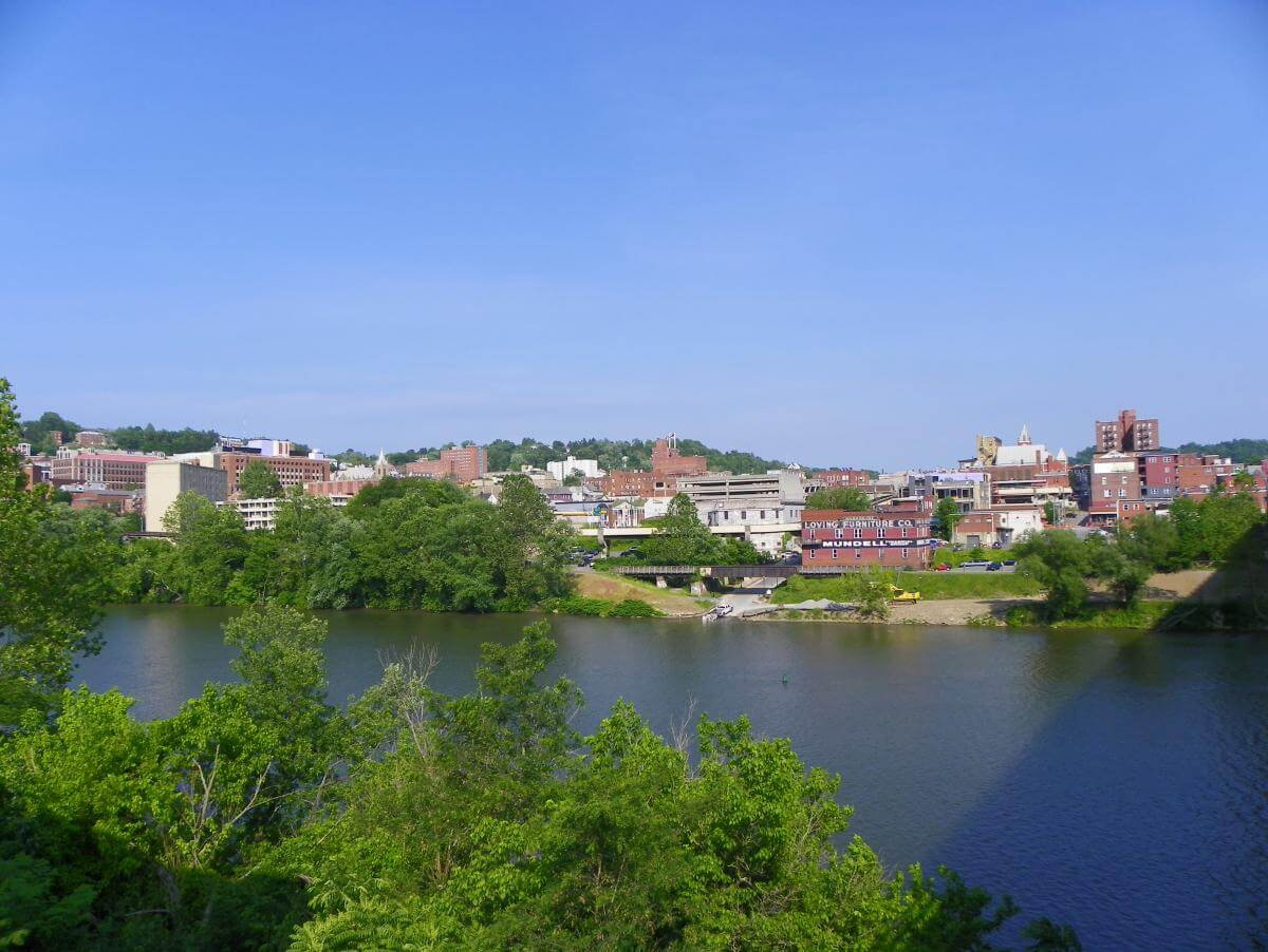 Photograph of the buildings of Morgantown, West Virginia from across a river.