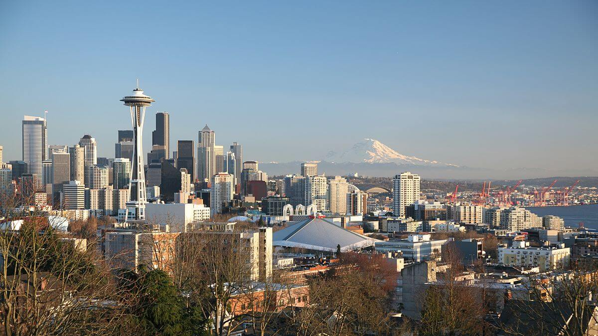 Photograph of the Seattle skyline on a sunny, cloudless day.