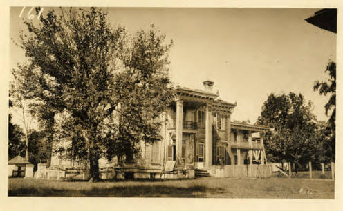 Side view of Malmaison, historic home of Greenwood Leflore, Carroll County, Mississippi, ca. 1923. Photograph by unknown creator. Courtesy of Mississippi State University Libraries, Special Collections Department, University Archives, Cooperative Extension Service Photographs, cdm16631.contentdm.oclc.org/cdm/ref/collection/charm/id/22827.